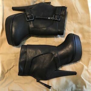 High heeled buckled booties